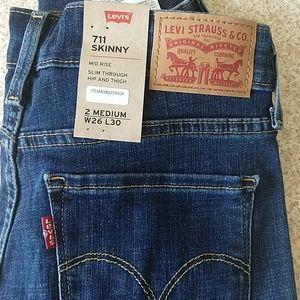 NWOT, Levi's 711, 26, distressed blue jeans